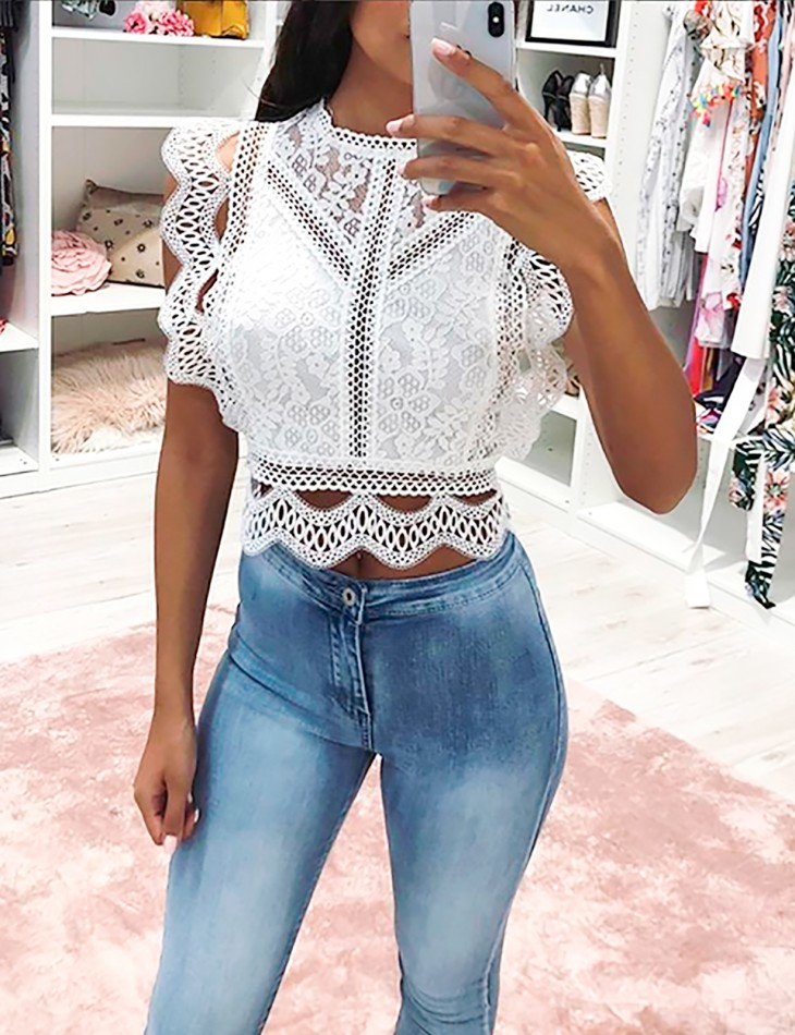 Top à broderies et zip
