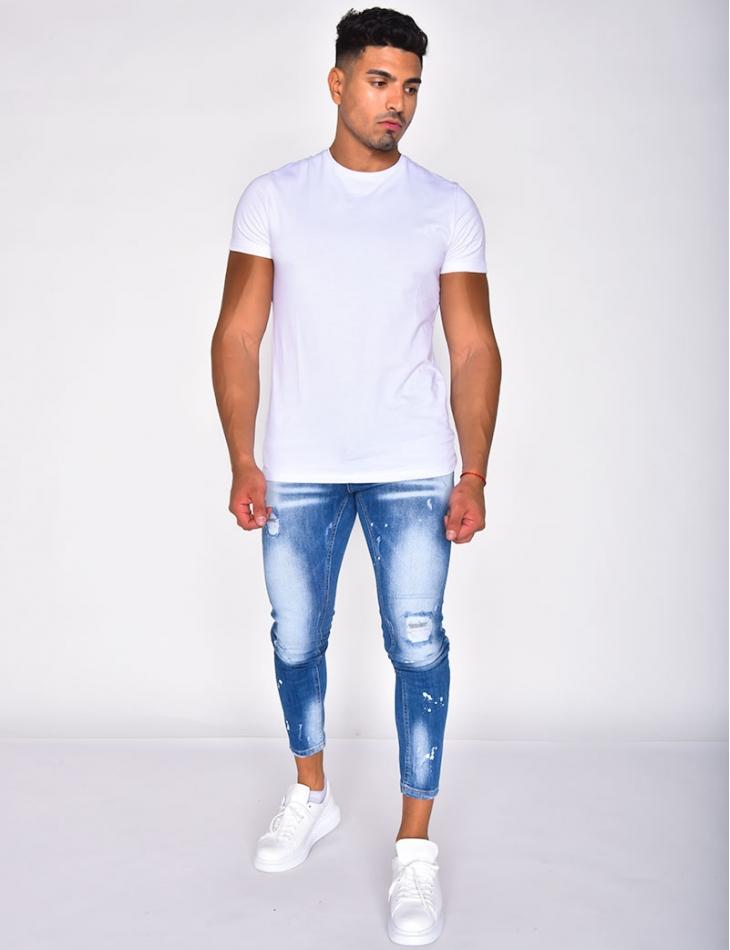 Jeans délavé destroy à taches