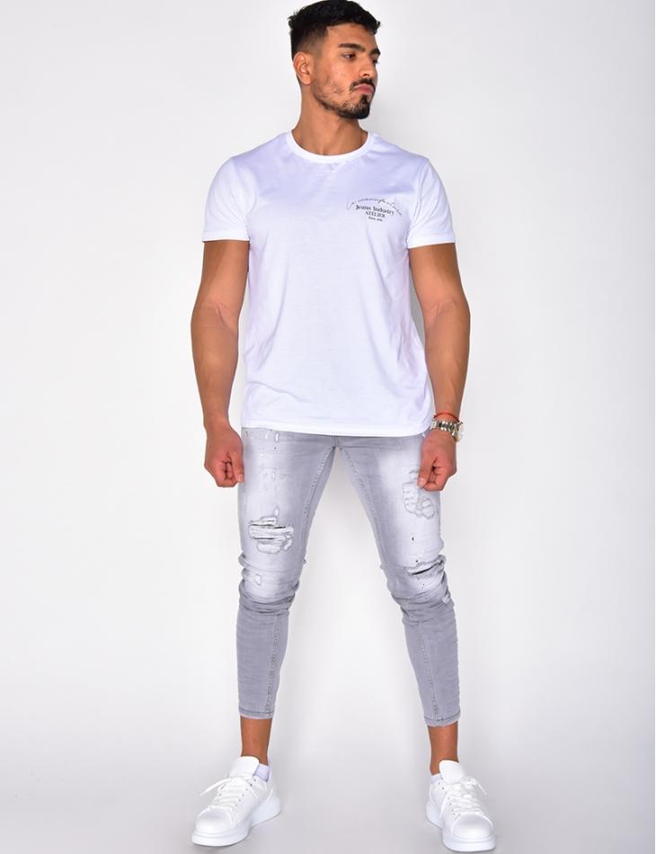 Jeans skinny à tâches de peinture