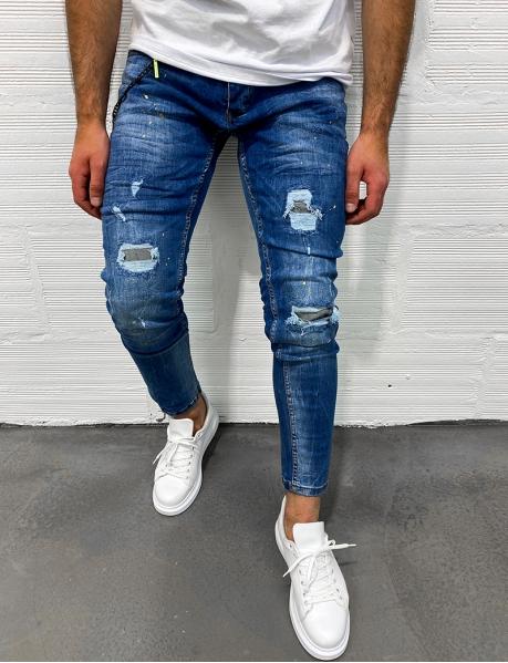 Jeans destroy à taches de peinture et chaine