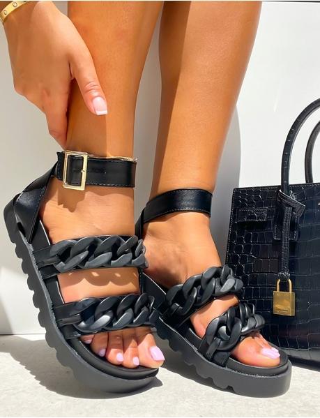 Sandales plates à semelle épaisse et lanière en cuir à gros maillons